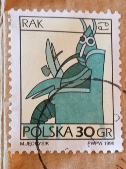 A pipe-smoking crab represents Cancer on the 30 groszy Polish postage stamp.