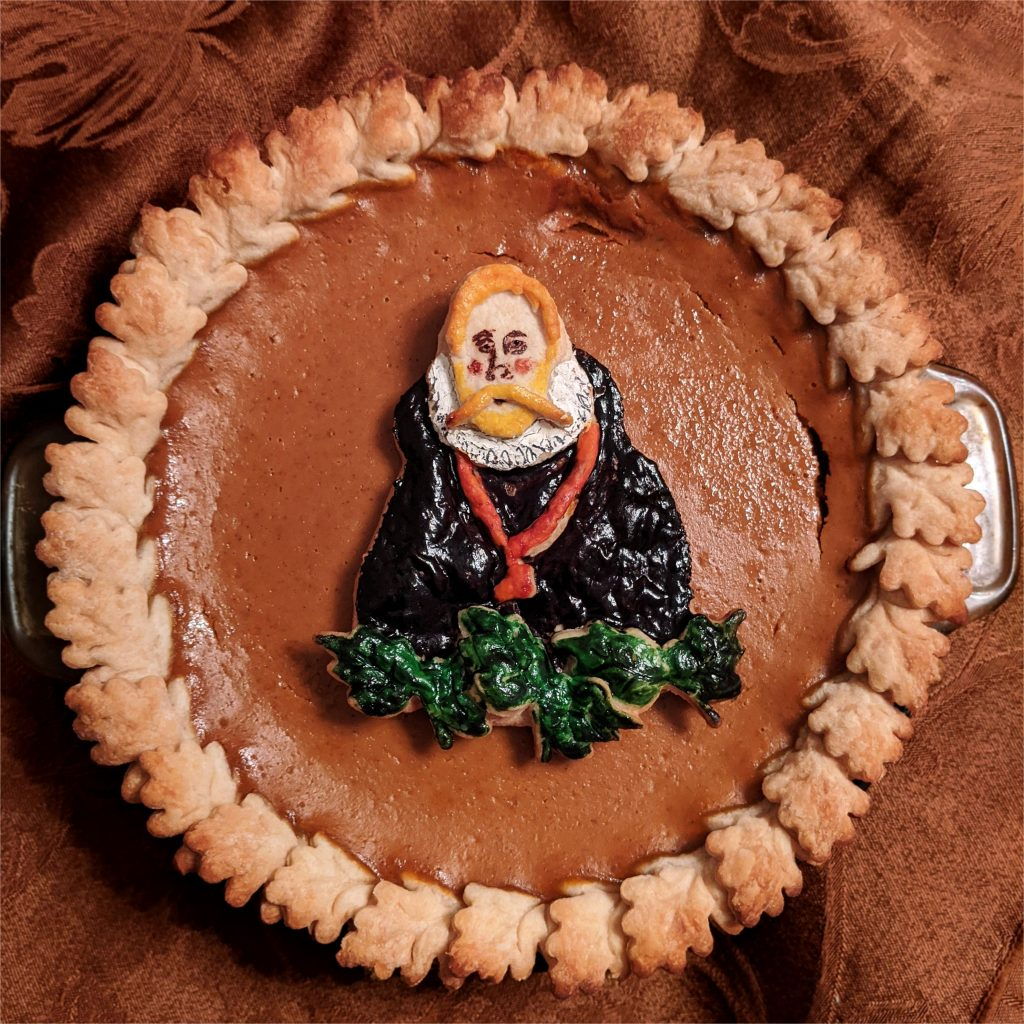 A photo of the pumpkin pie with an image of Tycho Brahe on it.