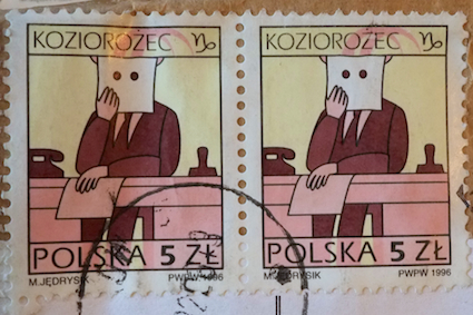 Capricorn the bureaucrat sits at a desk on the 5 złoty Polish postage stamp.