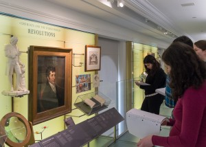 Students take notes at one of the displays in the CHF.