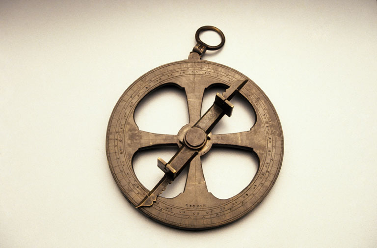 From this photo it is clear that Champlain's instrument was a mariner's astrolabe. From the Canadian Museum of History description—direct link to photo.
