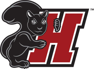 A rather annoyed looking black squirrel hugs the H in Haverford's athletic logos.